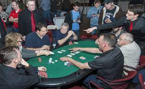 Group of poker players playing live poker